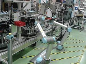 At a Renault car plant, robots drive screws into engines—a sign of their progress in handling small parts. Photo: Renault