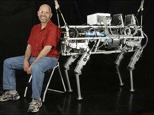 "CAPTION: CAMBRIDGE, MASS.--9/11/2004--BostonDynamics president Marc Raibert with the robot ""Big Dog"". CREDIT: JODI HILTON FOR THE NEW YORK TIMES"