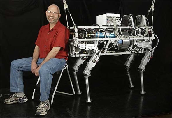 "CAPTION: CAMBRIDGE, MASS.--9/11/2004--BostonDynamics president Marc Raibert with the robot ""Big Dog"". CREDIT: JODI HILTON FOR THE NEW YORK TIMES"