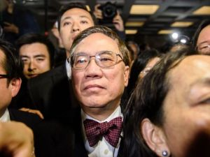 Former Hong Kong chief executive Donald Tsang leaves the High Court after the jury found him guilty of misconduct in Hong Kong on Feb. 17, 2017. Anthony Wallace—AFP/Getty Images
