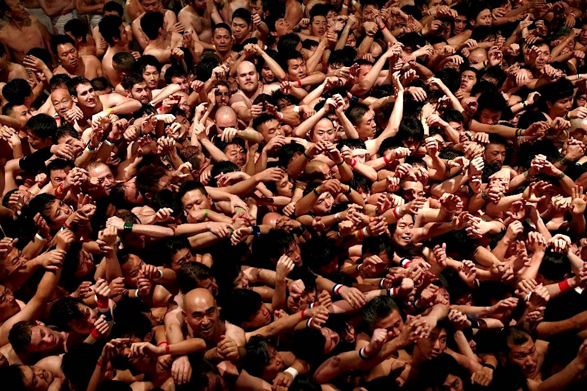 Around 10,000 hardy souls formed a writhing mass of sweaty worshippers inside Saidaiji Temple in Okayama, western Japan for the Naked Man Festival (AFP Photo/Behrouz MEHRI)