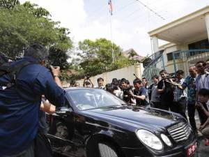 Journalists on Thursday followed a car that came out of the North Korean Embassy in Kuala Lumpur, Malaysia. Malaysian authorities said they have asked Pyongyang to deliver two North Korean suspects to them. PHOTO: AP PHOTO/VINCENT THIAN