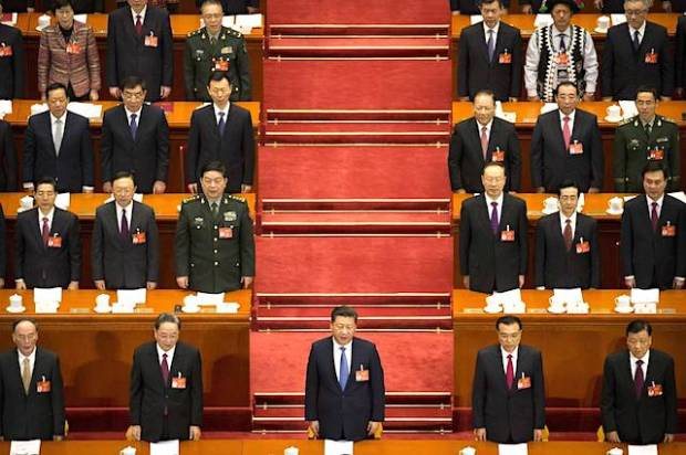 Chinese President Xi Jinping (center) stands during the start of the opening session of China's annual National People's Congress in Beijing's Great Hall of the People, Sunday, March 5, 2017. PHOTO: ASSOCIATED PRESS