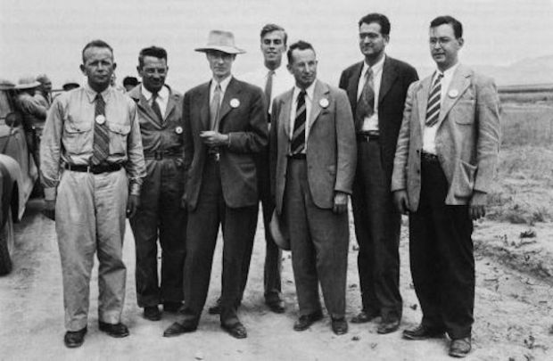 Manhattan Project physicists at Los Alamos, from left to right: Kenneth Bainbridge, Joseph Hoffman, J. Robert Oppenheimer, Louis Hempelman, Robert Bacher, Victor Weisskopf, Richard Dodson.