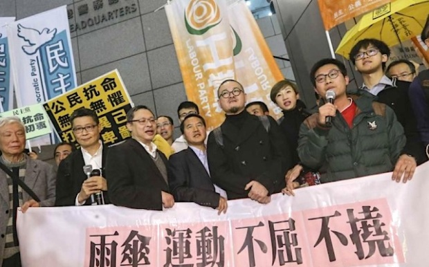 The nine Occupy movement activists outside Hong Kong police headquarters on Monday night. Photo: K. Y. Cheng