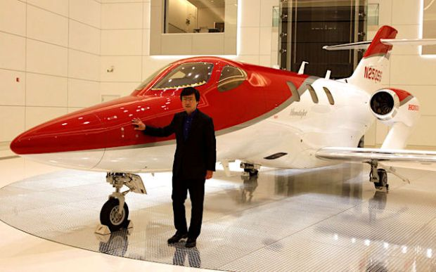 Reuters file photo CEO Michimasa Fujino poses next to Honda Motor's HondaJet business airplane at Honda Aircraft Co. in Greensboro, N.C., on Nov. 11, 2016.