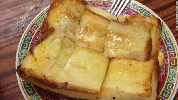 Hong Kong-style French toast usually incorporates two slices of butter-soaked bread, a layer of peanut butter, and super sweet maple syrup.