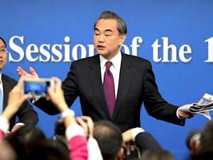 Chinese Foreign Minister Wang Yi gestures as he leaves following a press conference held on the sideline of the National People's Congress at the media center in Beijing, Wednesday, March 8, 2017. China on Wednesday proposed that North Korea could suspend its nuclear and missile activities in exchange for a halt in joint military drills conducted by the U.S. and South Korea. (AP Photo/Mark Schiefelbein)