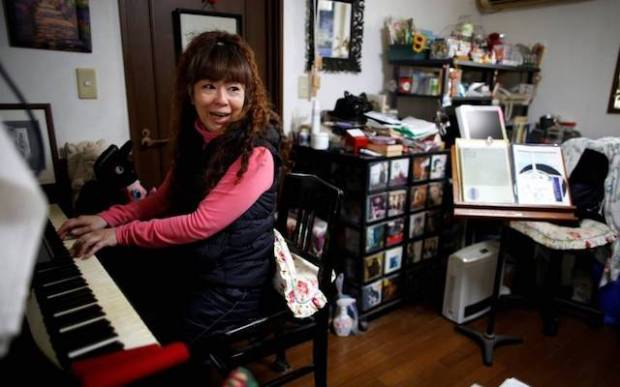Hiromi Tanaka, 54, says she relies on income from giving private singing lessons to a dwindling number of students, and her mother's pension to make ends meet. | REUTERS