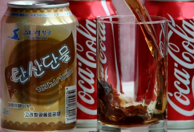 In this Tuesday, April 11, 2017, photo, a can of Air Koryo cola, produced by Air Koryo, the country's flagship airline which recently introduced its own brand of cola on flights to and from Beijing is seen in Pyongyang, North Korea. Coca Cola is possibly the world's most recognizable brand, an almost inescapable symbol of the global appeal of American-style consumer culture. There are only two countries in the world where Coke doesn't officially operate, and one of them is North Korea. (AP Photo/Wong Maye-E)