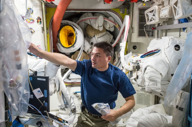 NASA astronaut Kjell Lindgren doing maintenance on the ISS space suits. Photo: NASA