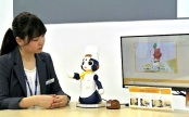 A robot explains its customer service system, which is being developed by Zensho Holdings Co. and Osaka University Prof. Hiroshi Ishiguro, in Minato Ward, Tokyo, on Thursday.