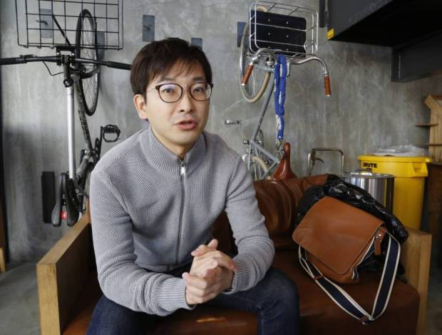 Yusuke Asakura, who heads a Tokyo-based angel network of entrepreneurs investing in global startups, is interviewed in Tokyo on Feb. 14. | AP