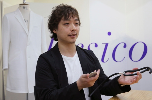 Tokyo-based startup Classico's chief executive, Arata Ohwa, shows a new stethoscope during an interview at his office in Tokyo in April 2016. | AP