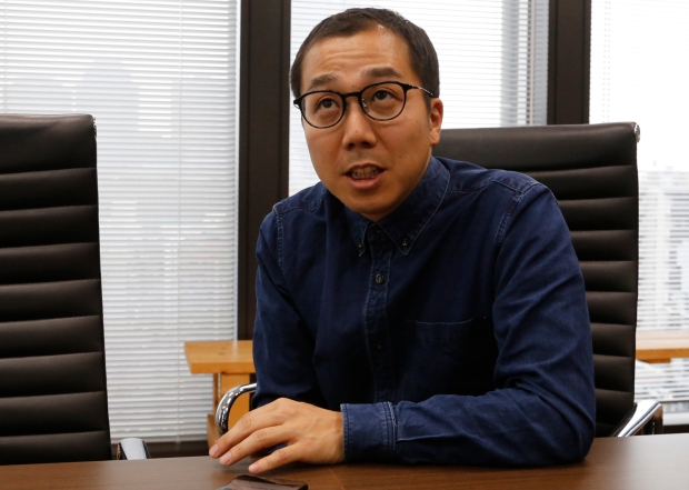Yusuke Umeda, co-chief executive of Tokyo-based startup Uzabase, is interviewed in Tokyo on March 2. | AP