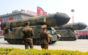 An apparent North Korean KN-08 intercontinental ballistic missile rolls through central Pyongyang on Saturday during a military parade marking the 105th anniversary of the birth of Kim Il Sung, the country's late founder. | AP
