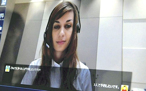 A woman talks via Skype with a new translation feature. Translations of entire conversations are provided in voice or via text on the screen.