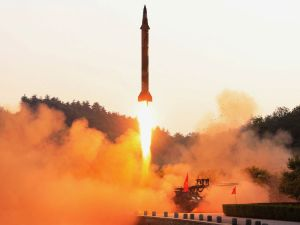 A ballistic rocket is test-fired through a precision control guidance system in this undated photo released by North Korea's Korean Central News Agency on Tuesday.KCNA via Reuters