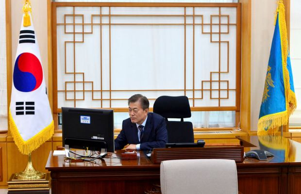Yonhap via AP South Korean President Moon Jae In works at the presidential Blue House in Seoul on Friday.