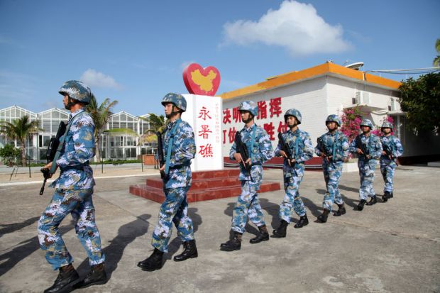 Soldiers of China's People's Liberation Army patrol at Fiery Cross Reef in the Spratly Islands in February 2016.