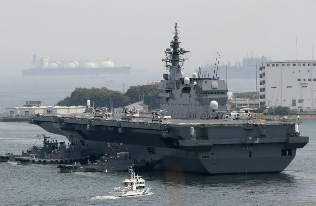 Japan on May 1 dispatched its biggest warship since World War II to protect a US supply ship, one of the country's military roles expanded under Prime Minister Shinzo Abe, as tensions mount in the region over North Korea Japan on May 1 dispatched its biggest warship since World War II to protect a US supply ship, one of the country's military roles expanded under Prime Minister Shinzo Abe, as tensions mount in the region over North Korea (AFP Photo/STR)