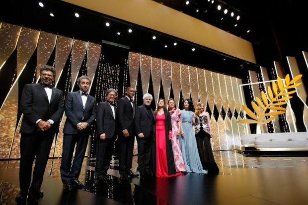 Reuters Director Pedro Almodovar, left, jury president of the 70th Cannes Film Festival, poses with jury members on stage on Wednesday.