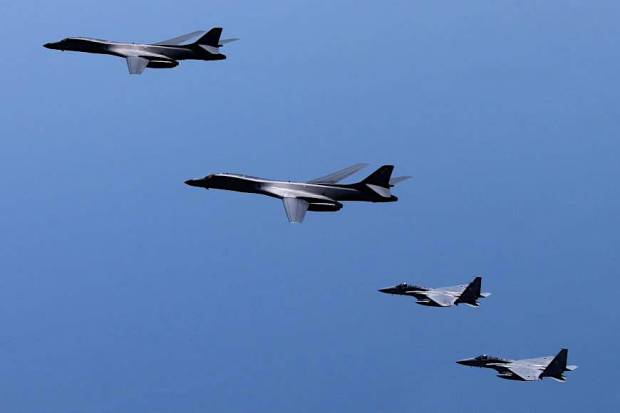 A pair of U.S. B-1B strategic bombers conduct joint drills with Air Self-Defense Force F-15s in airspace over the Kyushu region Monday. | JAPANESE DEFENSE MINISTRY