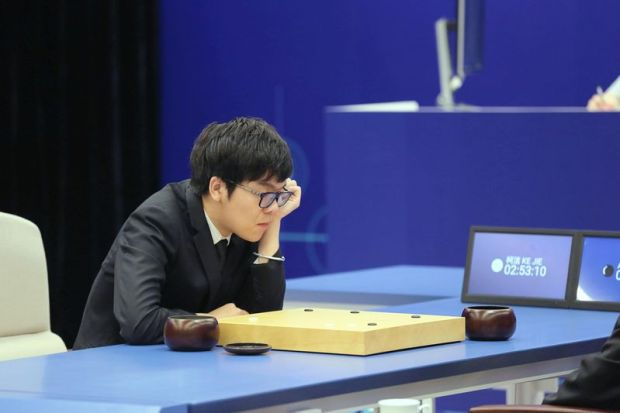 Reuters Chinese Go player Ke Jie competes against Google's artificial intelligence program AlphaGo in Wuzhen, China, on Saturday.
