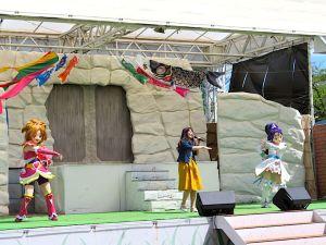 "Yuka Uchiyae, center, sings with ""Futari wa PreCure Splash Star"" lead characters on her sides at the Yomiuriland amusement park in Tokyo."