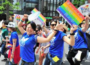 People march through Tokyo's Shibuya district on Sunday during the Tokyo Rainbow Pride parade. This year's theme was 'Change,' a call to respect everyone as individuals, regardless of sexuality. | YOSHIAKI MIURA