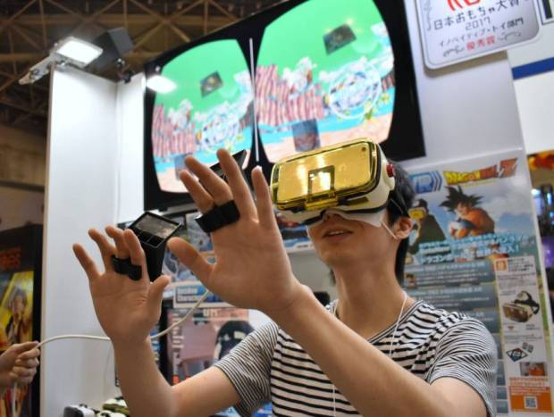 A man tries out a smartphone-assisted gadget called BotsNew Characters VR Dragon Ball Z as the annual International Tokyo Toy Show kicks off Thursday at Tokyo Big Sight in Koto Ward. | SATOKO KAWASAKI