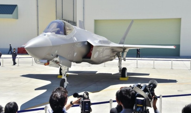 The Yomiuri Shimbun The first F-35A stealth fighter assembled in Japan is revealed at a Mitsubishi Heavy Industries Ltd. factory in Toyoyama, Aichi Prefecture, on Monday.
