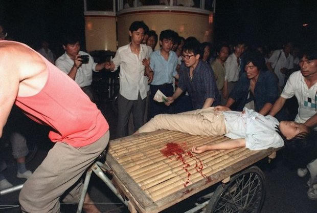 Rickshaw drivers risked their lives to try to rescue the wounded during the June 4 Massacre in Beijing in 1989. Credit Manuel Ceneta/Agence France-Presse — Getty Images