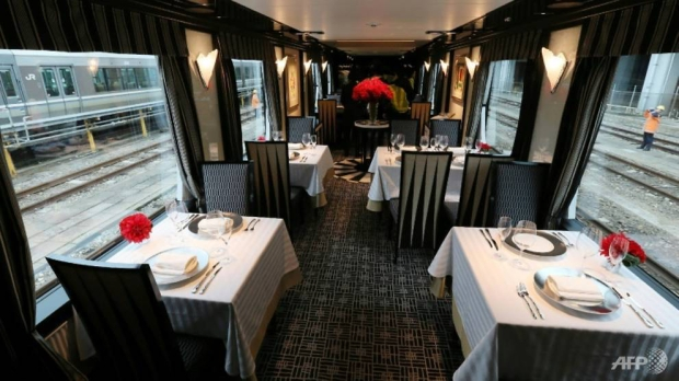 The dining car on Japan's latest super-deluxe train Twilight Express Mizukaze where passengers can enjoy food prepared by gourmet chefs AFP/STR