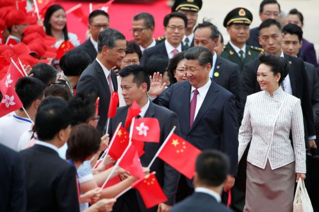 Chinese President Xi Jinping and his wife Peng Liyuan arrive at the airport in Hong Kong