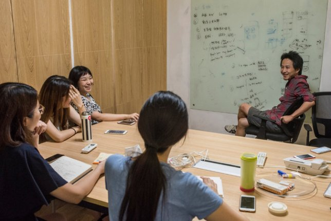 Alex Zhu, co-founder of Musical.ly, in a meeting with staff members at the company's offices in Shanghai. Gilles Sabrie for The New York Times
