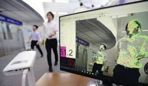 The Yomiuri Shimbun An emotion visualization system detects body tremors captured on camera and displays danger levels as colors and numerical values at the headquarters of ALSOK in Minato Ward, Tokyo, on July 12.