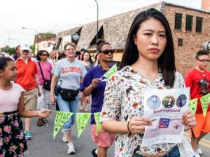 Fangqin Wan, a graduate student at the University of Illinois, walks for Yingying Zhang, a Chinese scholar who went missing three weeks ago, Thursday, June 29, 2017, in Urbana, Ill. Illinois students and others from the wider community are gathering at the Urbana-Champaign campus to show support for the Chinese scholar who disappeared three weeks ago. The News-Gazette via AP Holly Hart
