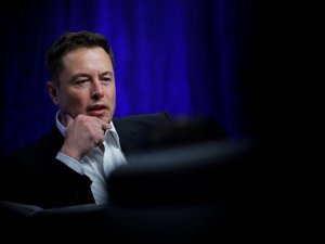 Elon Musk at the National Governors Association meeting in Providence, R.I., on Saturday. Mr. Musk warned about the dangers of artificial intelligence and said the high price of Tesla shares reflects optimism for the company's future. Photo: brian snyder/Reuters