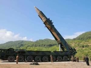 North Korean leader Kim Jong Un, second from right, inspects a Hwasong-14 intercontinental ballistic missile in North Korea's northwest in this July 4 file photo, distributed by the North Korean government. As North Korea advances its weapons systems, an increasing number of South Korean lawmakers say the south should develop its own nuclear arsenal. Korean Central News Agency/Korea News Service AP July 28, 2017 1:07 PM