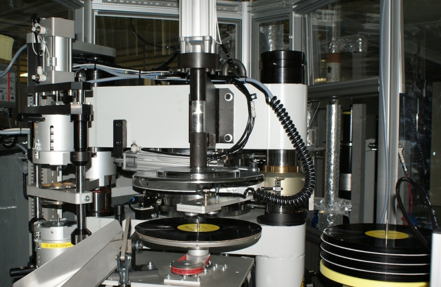 Record pressing and trimming equipment at Sony DADC Japan Inc. is shown in this handout photo. | COURTESY OF SONY MUSIC ENTERTAINMENT (JAPAN) INC. / VIA KYODO