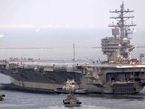 The aircraft carrier USS Ronald Reagan leaves its home port in Yokosuka, Kanagawa Prefecture, on Friday. | KYODO