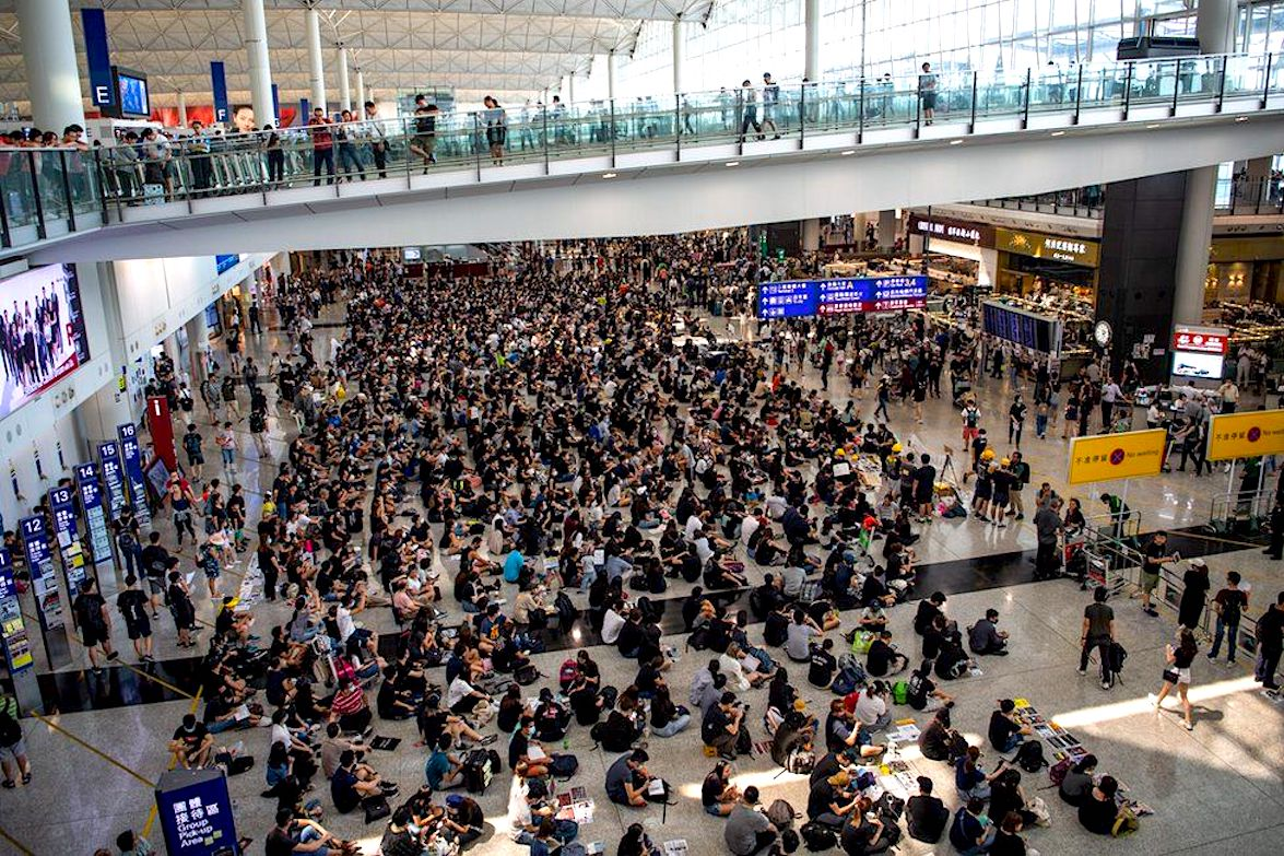 Hong Kong protests: Chaos as Activists Occupy Terminal